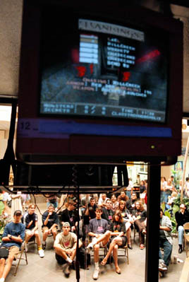 Spectators watch the game on monitors outside the darkened Slam Site in a mall in Burbank